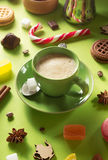 Cup of coffee at green background Royalty Free Stock Photos