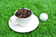 Cup of coffee on green grass Royalty Free Stock Photos