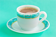 Cup of coffee on green table Royalty Free Stock Image