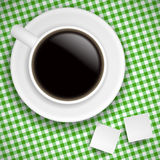 Cup of coffee on green tablecloth Royalty Free Stock Image
