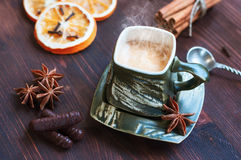 Cup of coffee with grief spice star anise and cinnamon Royalty Free Stock Photos