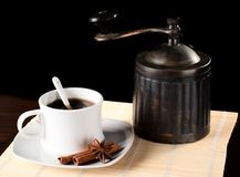 A cup of coffee with grinder. Royalty Free Stock Images