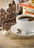 Cup of coffee and grinder Stock Image