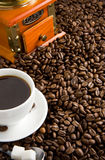 Cup of coffee and grinder Stock Photos