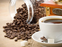 Cup of coffee and grinder Stock Photo