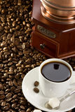 Cup of coffee and grinder Royalty Free Stock Photo