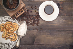 Cup with coffee grinder and coffee beans. vintage Stock Photo