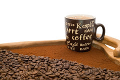 Cup of coffee, ground coffee and coffee beans Royalty Free Stock Images