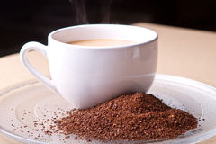 Cup of coffee with grounds Stock Images