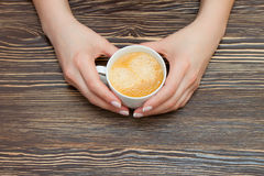 Cup of coffee in hand Royalty Free Stock Image