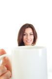 Cup of coffee in hand of pretty young woman Royalty Free Stock Images