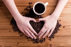 Cup of coffee in hand, top view Stock Photo