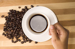 Cup of coffee in hand Stock Images