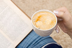 Cup of coffee in hand Stock Photos