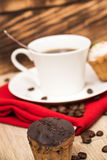 Cup of coffee and a handful of homemade biscotti with chocolate and almonds on a wooden table Royalty Free Stock Photo