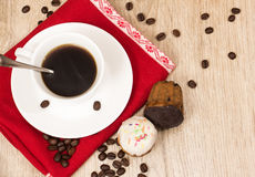 Cup of coffee and a handful of homemade biscotti with chocolate and almonds on a wooden table Stock Images