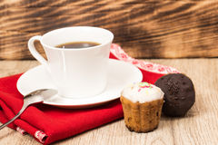 Cup of coffee and a handful of homemade biscotti with chocolate and almonds on a wooden table Royalty Free Stock Photos