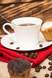 Cup of coffee and a handful of homemade biscotti with chocolate and almonds on a wooden table Stock Photo