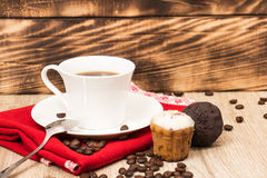 Cup of coffee and a handful of homemade biscotti with chocolate and almonds on a wooden table Stock Photos