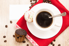 Cup of coffee and a handful of homemade biscotti with chocolate and almonds on a wooden table Royalty Free Stock Image