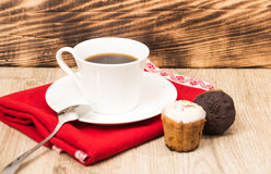 Cup of coffee and a handful of homemade biscotti with chocolate and almonds on a wooden table Royalty Free Stock Images