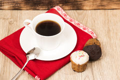 Cup of coffee and a handful of homemade biscotti with chocolate and almonds on a wooden table Stock Photography