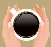 Cup of coffee in hands Stock Images