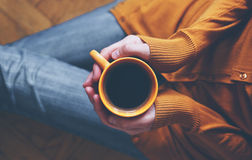 Cup of coffee in hands Stock Photo