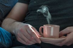 Cup of coffee in the hands of man Stock Photo