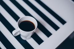 A cup of coffee on wooden texture. A cup of coffee in hands. Morning time Stock Photography