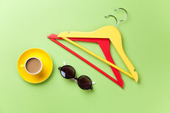 Cup of coffee and hangers with sunglasses Royalty Free Stock Photos