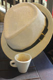 Cup of coffee and an hat. A cup of coffee and an hat Stock Photo
