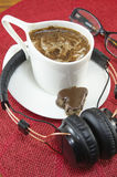 Cup of coffee and headphones Royalty Free Stock Photo