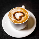 Cup of coffee. With heart in bar Royalty Free Stock Photography