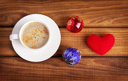 Cup of coffee, heart and christmas bubbles Royalty Free Stock Image