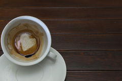Cup of coffee with Heart of Coffee Grounds on Bar Stock Photography