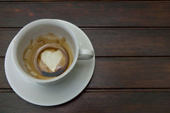 Cup of coffee with Heart of Coffee Grounds on Bar Royalty Free Stock Photography