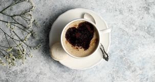 Cup of coffee with heart made of foam stock video