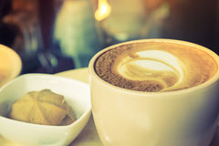 Cup of coffee with heart pattern Stock Photography
