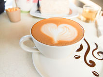 Cup of coffee with heart pattern in a white cup Royalty Free Stock Images