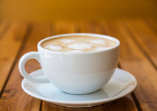 Cup of coffee with heart pattern in a white cup Royalty Free Stock Photography