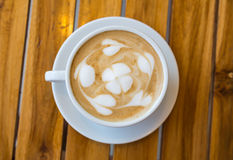 Cup of coffee with heart pattern in a white cup Stock Images