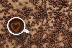 Cup of coffee with a heart is on sacking Royalty Free Stock Photo