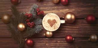 Cup of coffee with heart shape and christmas toys Royalty Free Stock Images