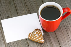 Cup of coffee and heart shape cookie Stock Images