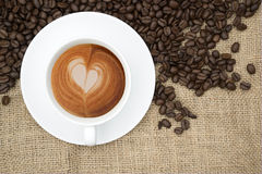 Cup of coffee with heart shape in foam Stock Photo