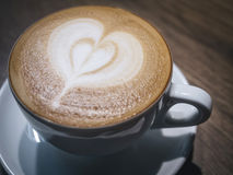 Cup of coffee with heart shape foam close up Stock Photo