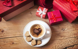 Cup of Coffee with Heart Shape near Christmas Gifts Stock Photography
