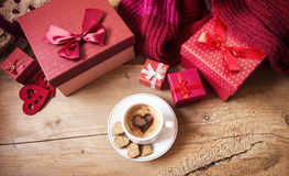 Cup of Coffee with Heart Shape near Christmas Gifts Royalty Free Stock Image