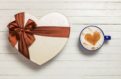 Cup of coffee with heart shape symbol and gift box Royalty Free Stock Photography